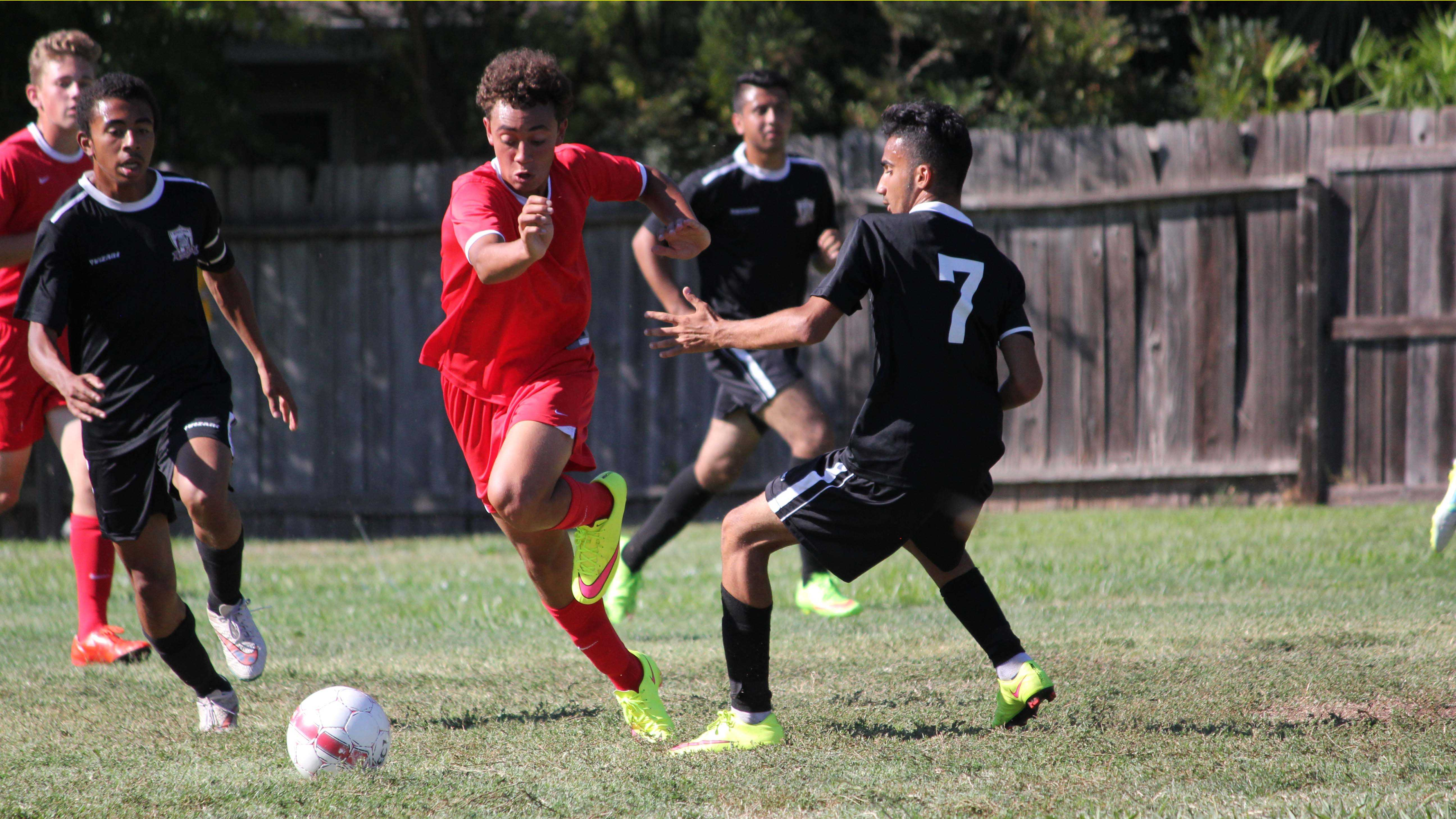 Sophomore B.J. Askew (center) scored within the first six minutes of the Cavs' game against Encina High School and finished with two more goals, completing a hat track, in the Cavs' second game of the season, which resulted in a tie.