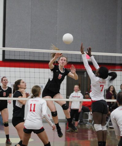 Senior Jenny Kerbs jumps to spike during the third set of the Cavs' first round of playoffs on Nov. 12 against the Victory Christian Vikings.