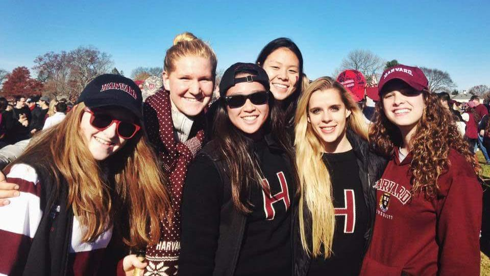 Claire Pinson, '15,  (second from left) and her friends tailgate at a Harvard football game against Yale.