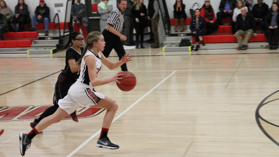 Freshman+Heidi+Johnson+pushes+the+ball+up+the+court+in+the+varsity+girls%27+34-25+win+over+Buckingham+Charter%2C+Jan.+22.+Johnson+had+11+points.++