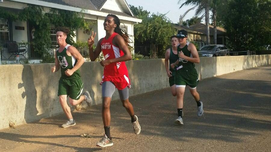 Nine players run in season's first cross country meet; coach wants to take back varsity boys' league title