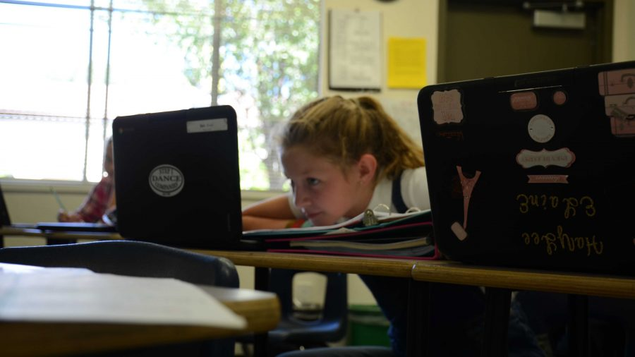 Sixth graders receive cost-saving Chromebook laptops custom-made for schools in place of iPads