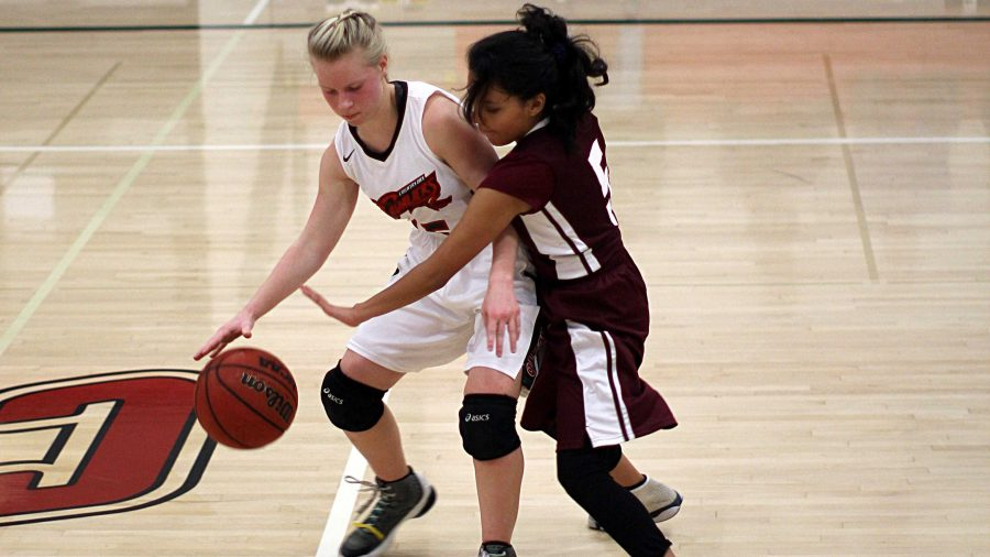 Girls' JV basketball becomes more aggressive, but discomfort with ball handling leads to defeat from Natomas