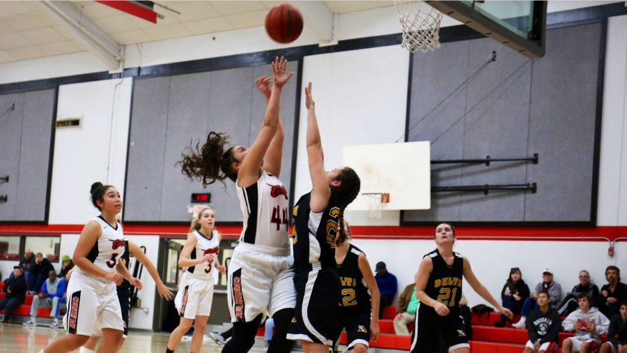 After learning much from their previous game, girls' varsity basketball defeats Delta High School