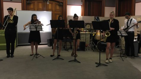 Sophomore receives complimentary speech as high-school jazz band performs at Youth Art Month reception (video included)